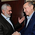 Received warm welcome. Haniyeh and Erdogan Photo: AP