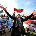 Protestors outside courthouse where Mubarak's trial held Photo: MCT
