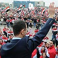 Assad addresses supporters Photo: AFP