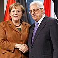 German Chancellor Angela Merkel and Mahmoud Abbas Photo: EPA