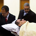 Mubarak taken into court room Photo: AFP