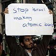 Protestors greet IAEA inspectors Photo: AP