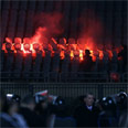 Fans set fire to seats Photo: AFP