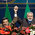Ahmadinejad (L) and Haniyeh (archives) Photo: AP