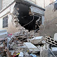 Wreckage on streets of Baba Amro Photo: Reuters