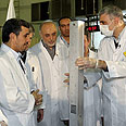 Ahmadinejad visiting the center Photo: EPA