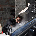 Palestinian kid throws stone at Weiss' car Photo: AFP
