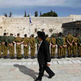 Haredi man, soldiers at Western Wall Photo: Reuters