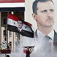 Pro-Assad rally in Syria Photo: Reuters