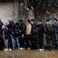 Queueing for bread Photo: Reuters