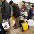 Gazans line up for fuel (archives) Photo: Reuters