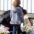 Laying wreaths near Toulouse school Photo: AFP