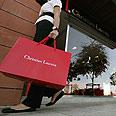 Lebanese woman carries a Christian Lacroix bag Photo: AFP