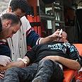 Evacuating injured Palestinian Photo: Activestills