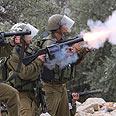 Soldiers firing in Naalin Photo: Activestills