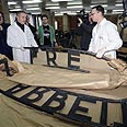 Arbeit Macht Frei sign recovered, sliced in three Photo: AP