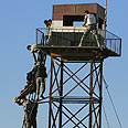 Egyptian soldier's body lowered from observation post Photo: AFP