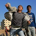 Palestinian youths riot near Rafah Photo: AFP
