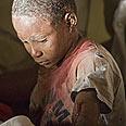 Young survivor Photo: AP