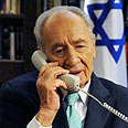 President Peres on the phone Photo: Moshe Milner, GPO