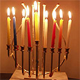 Rabbi praises new policy. Hanukkah menorah Photo: Ronen Yules