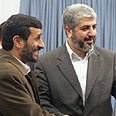 Ahmadinejad and Mashaal in Tehran on Tuesday Photo: AFP