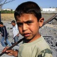 Palestinian boy following IDF strike in Jabalya Photo: AFP