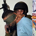 Soldier arresting wanted Palestinian (Archive photo) Photo: AP