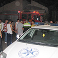 Police near stricken house Photo: Rai Tal Braunstein