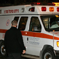 Ambulance takes Sharon to hospital Photo: AP
