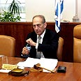 Acting PM Olmert by Ariel Sharon's empty chair Photo: Reuters