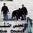 Hamas members break into PA building in Ramallah Photo: Reuters
