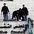 Hamas members break into PA building in Ramallah Photo: Reuters