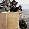 Settlers prepare for clashes in Amona Photo: Reuters