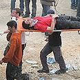 Amona – evacuating the wounded Photo: Gil Yohanan