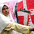 Indonesian woman protesting cartoons Photo: Reuters