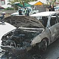 Car torched outside officer's home Photo: Yossi Zeliger