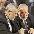Hamas PM Haniyeh (L) with Baher (archives) Photo: AFP