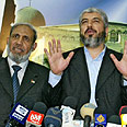 Mahmoud al-Zahhar (left) with Khaled Mashaal Photo: AFP
