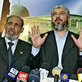 Mahmoud al-Zahhar (left) with Khaled Mashaal Photo: AFP