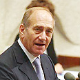 Olmert. &#39;Compensate evacuees&#39; Photo: Gil Yohanan