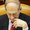 Wants to cut defense budget. Olmert Photo: AFP