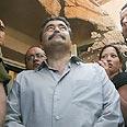 Peretz tours home hit by Qassam Photo: Tsafrir Aviov