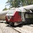Overturned train cars Photo: Ronen Boidak