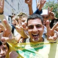 Hizbullah supporters celebrate Photo: Reuters