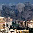 Smoke billowing over B=eirut after Israeli raid Photo: Reuters