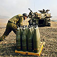 IDF soldier checking artillery shells Photo: AP