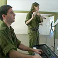 'Torn between Halacha and military orders.' Female soldier in IDF band Photo: Shai Rosenzweig