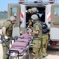 Evacuating the wounded in previous Bint Jbeil battle Photo: Niv Calderon
