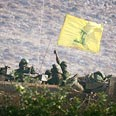 Hizbullah flag: flown for first time at parliament Photo: Reuters